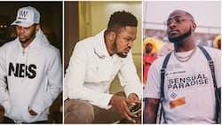 Kizz Daniel stands with his manager after Davido reportedly slapped him at his concert