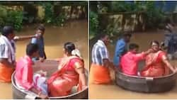 Couple float to wedding venue in giant cooking pot as flood threatens their big day, adorable photos emerge