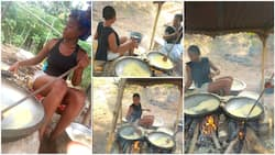Nigerian lady who fries yellow garri for a living showcases her work in viral photos