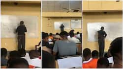 UNN lecturer gets stuck on the board while solving Physics question in viral video, students laugh
