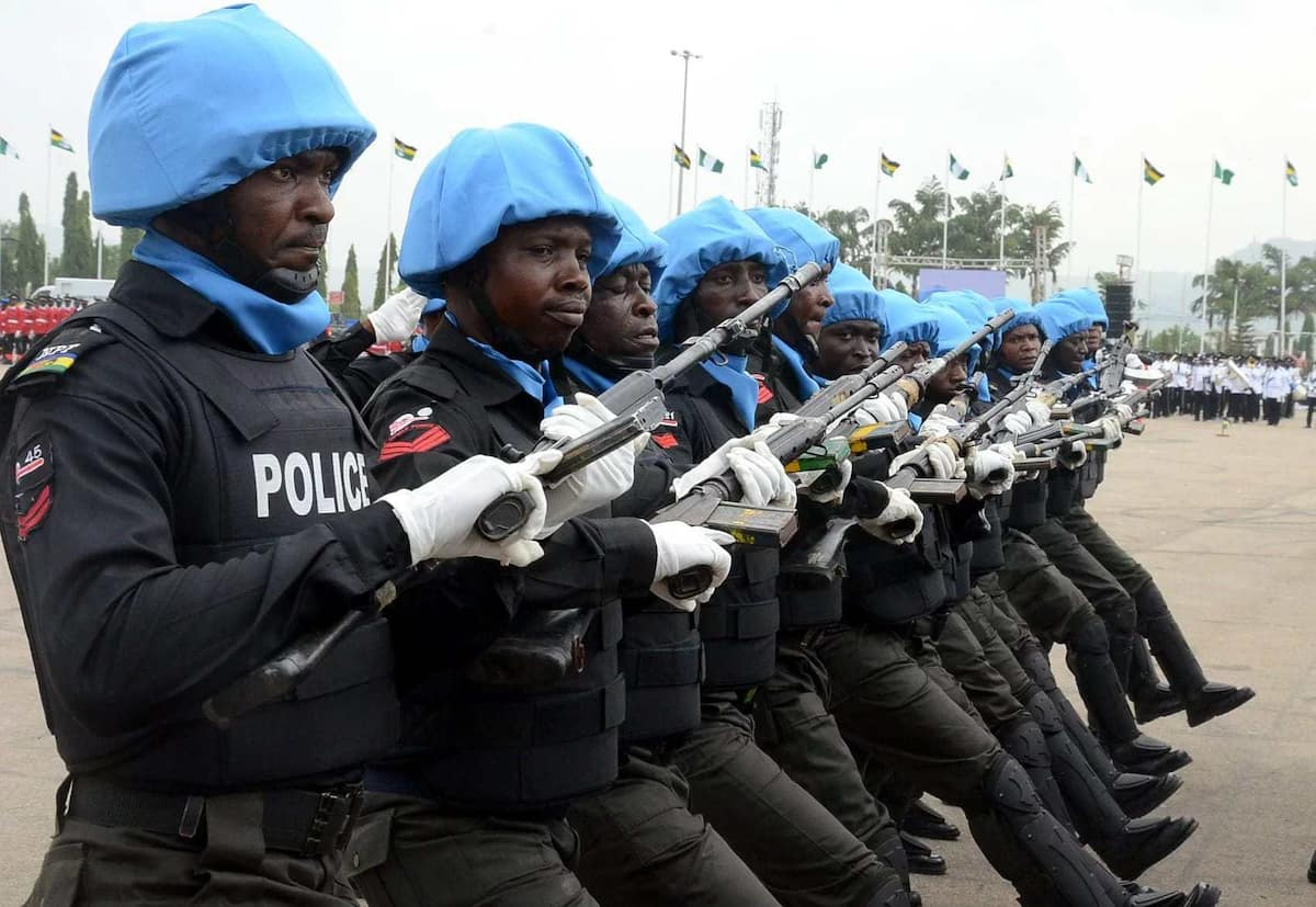 Image result for image of Nigerian police matching