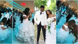 Bride in long white gown scatters dancefloor with amazing steps, teaches bridesmaid, groomsmen how to dance