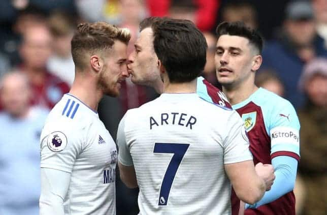 Burnley's Ashley Barnes kisses Joe Bennett on the pitch and gets booked