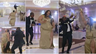 Drama as lady 'scatters' wedding, removes her wig as she dances and shoots dollars in the air, video wows many