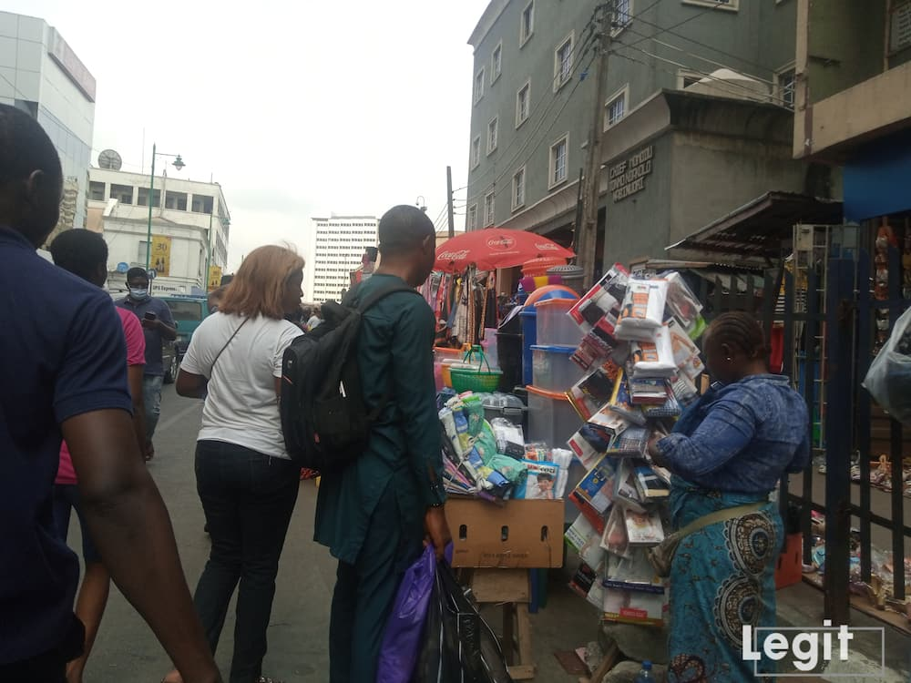A trader attending to her customer at a popular Lagos market. Photo credit: Esther Odili