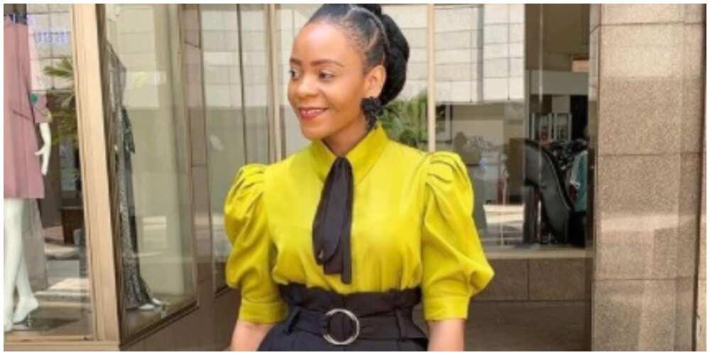 Photo of a lady in office wear.