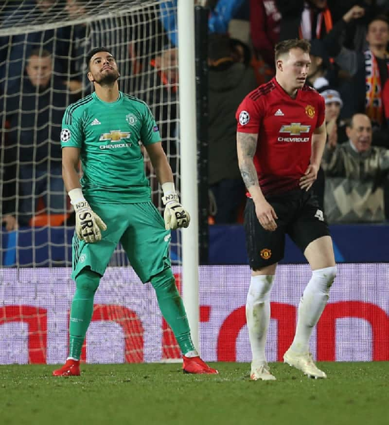Phil Jones and Sergio Romero during one of their games for Manchester United. Photo by John Peters.