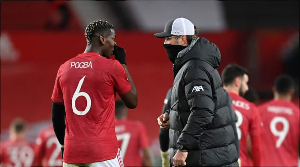 Panic for Solskjaer as lengthy chat between Liverpool boss Jurgen Klopp and Pogba is revealed
