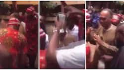 Nigerian university graduates celebrate their lecturer, dance and rain cash on him in adorable video