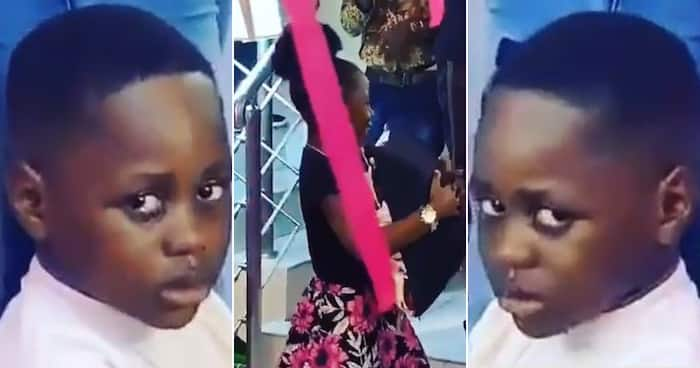 Dad shares video of son frowning during his sister's colourful