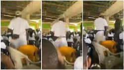 Soldier punishes corps member for sleeping in camp, video shows him jumping up and down, people laugh