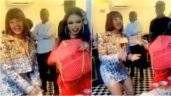 Bobrisky spotted spraying money on Tacha at her birthday party (video)