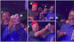 Secure the bag: Reactions as Kanayo O. Kanayo holds on tightly to wads of cash sprayed on him at party
