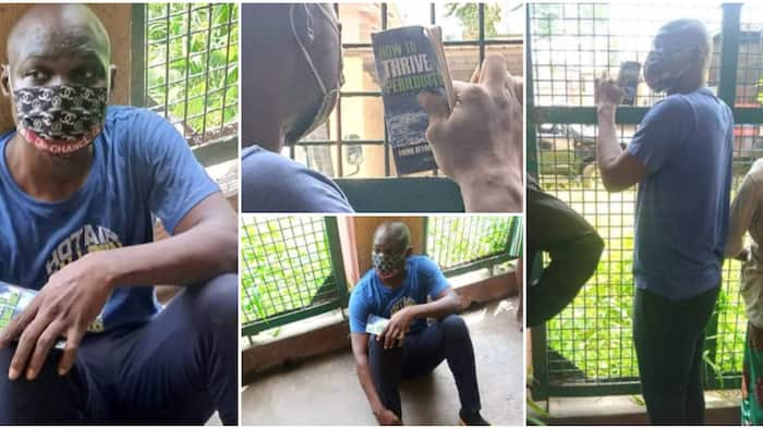 Photos of Baba Ijesha holding on tightly to inspirational book on surviving hard times as he awaits hearing
