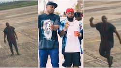 My oga get money: Davido's logistics manager Israel DMW screams at airport with bell in his hand, many react