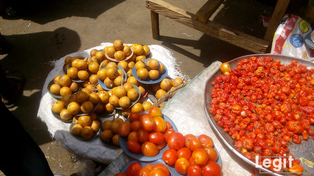 African star apple, tomatoes and pepper on display at a popular market in Lagos. Photo credit: Esther Odili
