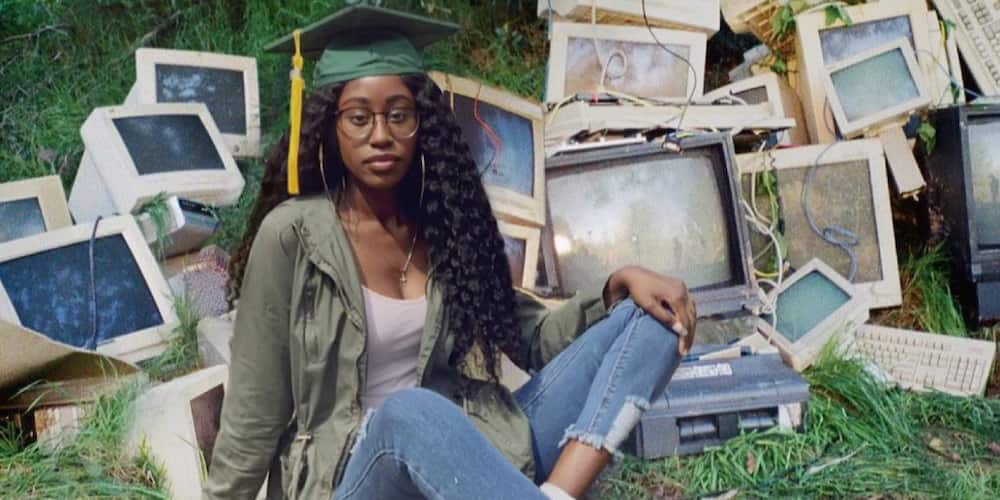 So cute: Huge reactions as lady shares adorable graduation photo of herself posing in front of many computers