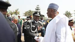 Updated: Saraki shakes hands with IGP Idris at Armed Forces Remembrance Day celebration