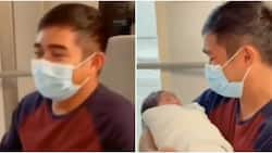 Emotional moment father carries his baby for the first time captured on camera, cute video warms hearts online