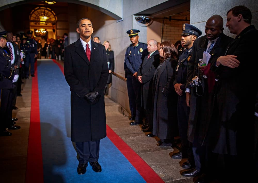 Obama waits to walk out as the 44th President of the United States in 2009