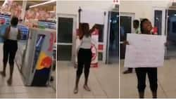 Nigerian lady storms South African mall in Lagos to do a one-man peaceful protest against xenophobia