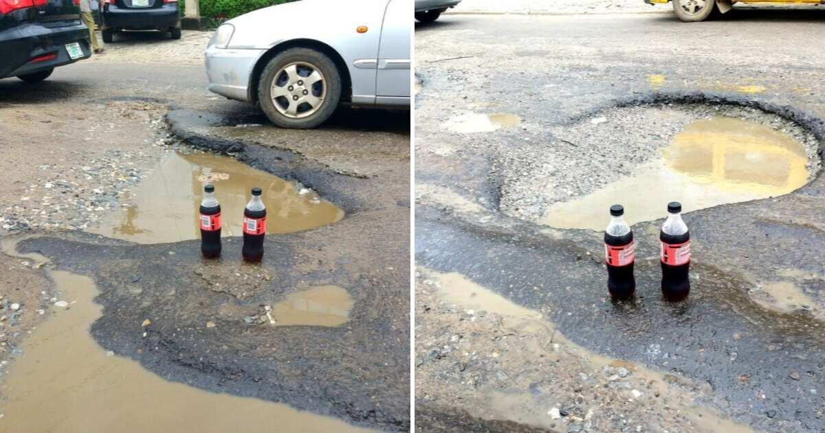 Nigerian man celebrates potholes on Ikeja with bottles of cola beverages (photos) - Legit.ng
