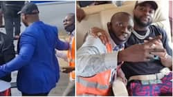Davido invites airport staff into his jet, takes photo with him moments after bodyguard pushed him away