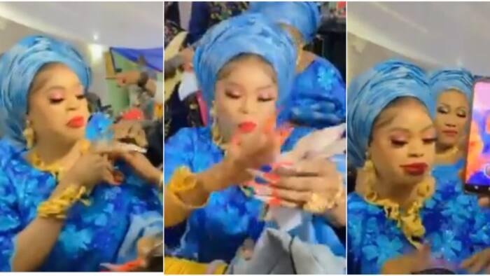Risky doings: Bobrisky recreates Oba scene in video, sprays cash as Yinka Ayefele sings his praise