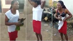 Nigerian man seen on camera removing his clothes after he was caught disguising as a woman (video)