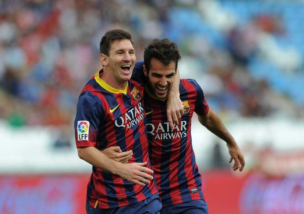 Cesc Fabregas and Messi