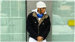 Curious fan tackles Tekno for wearing jacket in 'Italy despite the heat, singer responds
