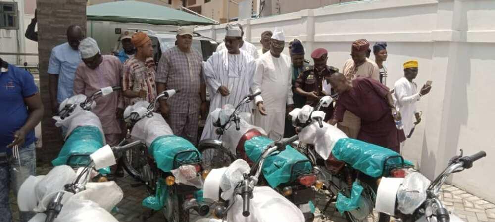 Gani Adams distributes bicycles