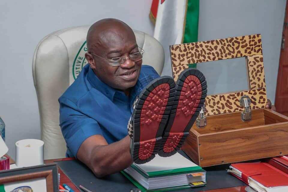 Abia Governor Ikpeazu Turns Shoemaker, Displays Sandals Made by Him