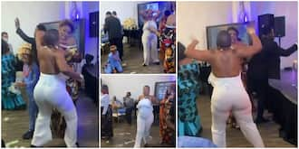 Lady on armless dress thrills guests at birthday party with weird marching dance moves in viral video