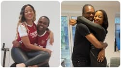 Nigerian legend Kanu cuddles wife passionately to celebrate Arsenal's victory over London rivals Tottenham