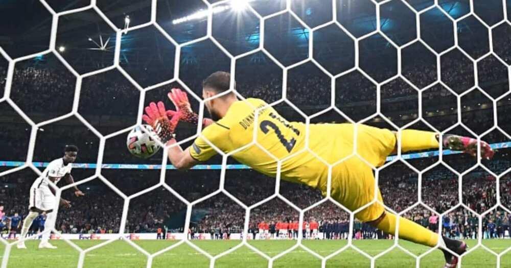 Italy keeper Donnarrumma saves Saka's crucial penalty. Photo by Paul ELLIS.