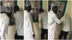 Tension in the air as Nigerian father follows his son to check results on school's notice board