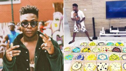 Reekado Banks marks birthday in special way, gets 25 birthday cakes from his brother and family