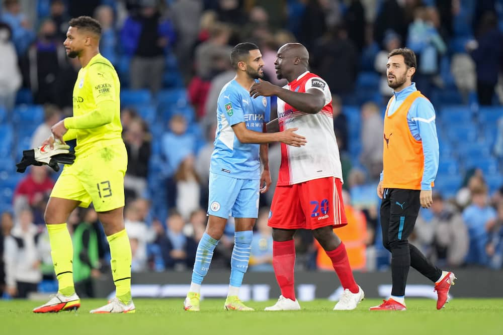 Akinfenwa in action against Man City