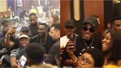 Fans gather to take selfie as Super Eagles legend Emenike spotted partying with AY comedian in Dubai