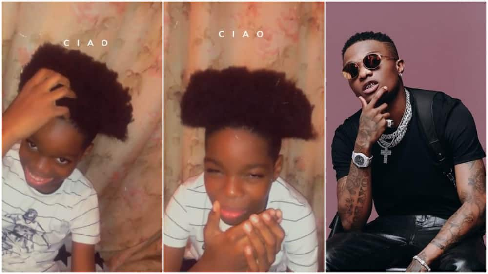 Wizkid's son Tife rocks new hairstyle in viral video, covers his face in shyness