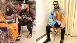 Cute video of singer Flavour playing guitar for his father in Enugu