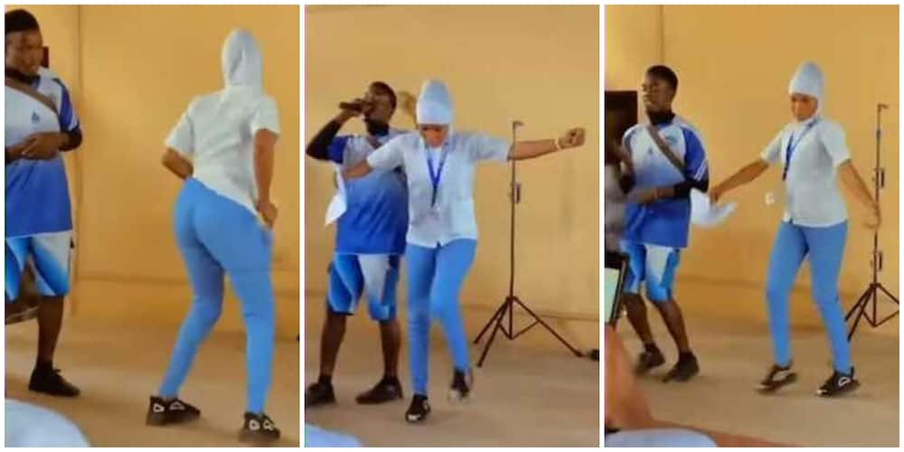 Nigerians react to video of uniformed Muslim lady in hijab doing legwork on stage