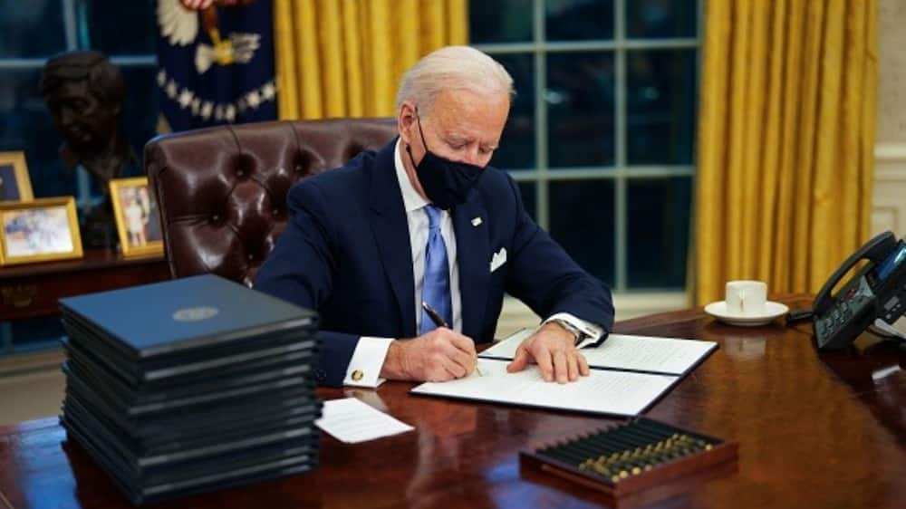 Biden signs 17 executive orders to reverse Trump policies