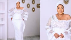 Owanbe ready: Toyin Abraham rocks stunning white lace with asymmetric neckline