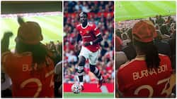 Burna Boy storms Old Trafford with his mum to support Pogba, celebrates in style after Ronaldo's brace
