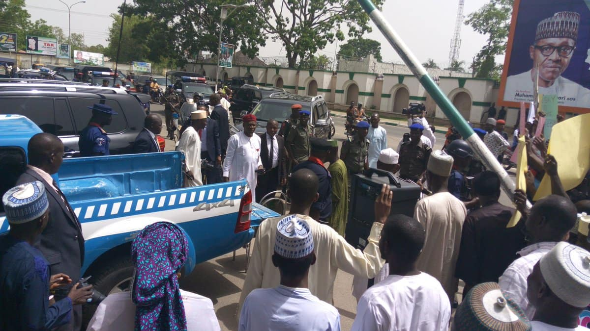 Image result for Abubakar pelted with bottles at  the Supreme Court