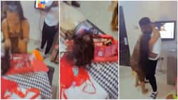 Lady almost runs 'mad', screams for joy as lover gives her bone straight hair, Nigerians react (see video)