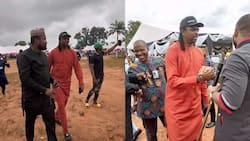 Super Eagles legend Kanu storms Oba in style for Obi Cubana mom's burial as fans rush to take selfie with him