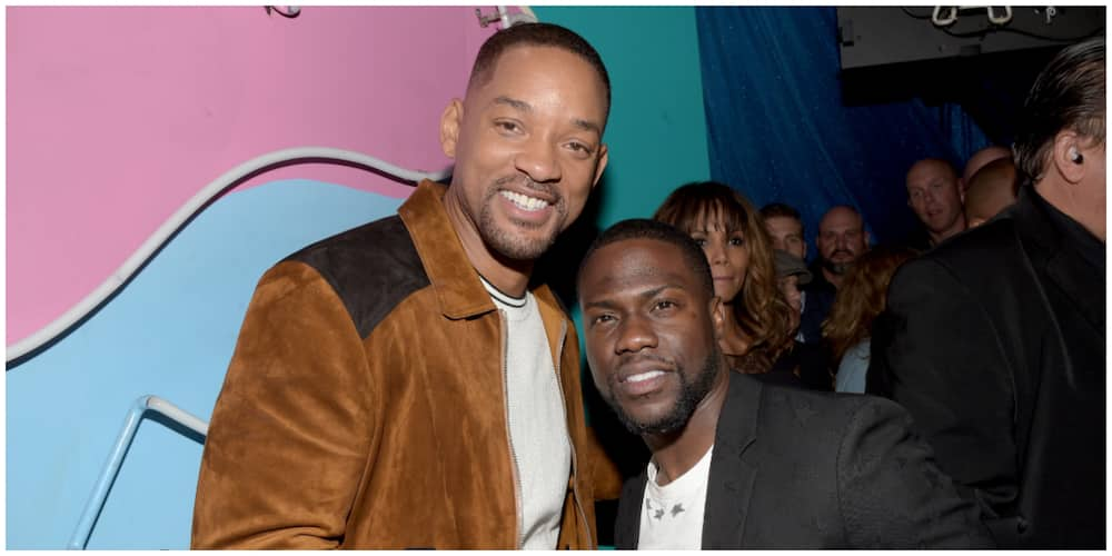 A photo of Will Smith and Kevin Hart at an event.